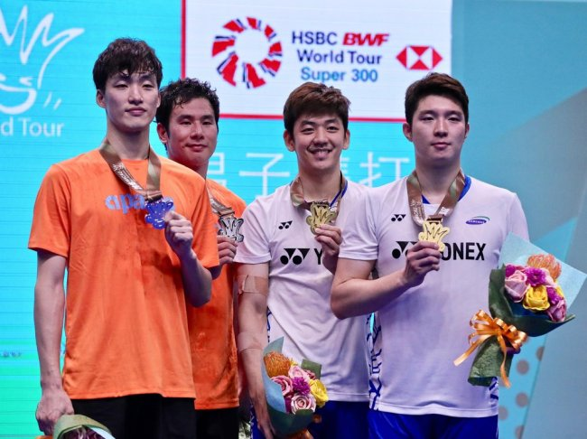 Shin Baek-cheol, Ko Sung-hyun, Lee Yong-dae and Kim Gi-jung badmintion players (Yonhap)