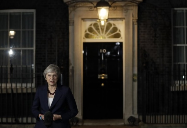 Britain`s Prime Minister Theresa May delivers a speech outside 10 Downing Street in London, Wednesday, Nov. 14, 2018. British Prime Minister Theresa May says Cabinet agrees draft Brexit deal with European Union after `impassioned` debate. (AP)