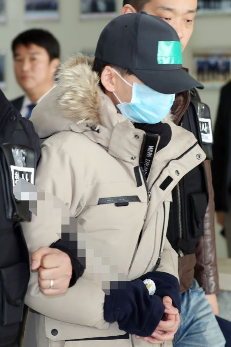 One of four middle-school students arrested in the death of a classmate wearing the victim's jacket, Oct. 16, 2018 (Yonhap)