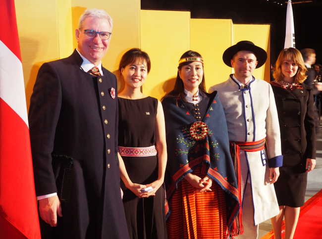 Latvian Ambassador to Korea Peteris Vaivars (left) poses with his spouse, Rina (center), and Latvian Embassy staff at the National Day reception in Seoul on Friday. (Joel Lee/The Korea Herald)