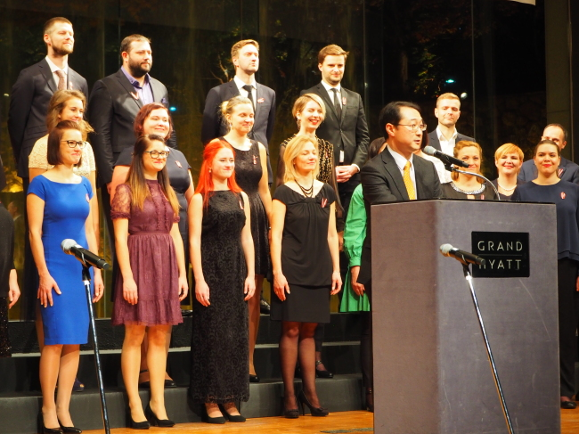 At the reception, the Emils Darzins Mixed Choir from Latvia sang both countries' anthems and Latvian songs. (Joel Lee/The Korea Herald)