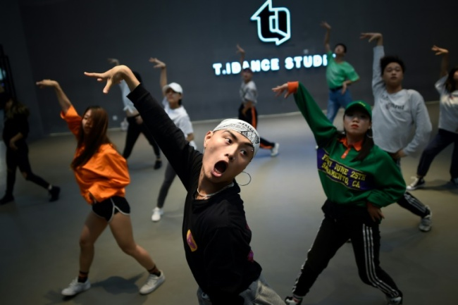Although China`s street dance scene took root in the 2000s it wasn`t until recently that it exploded into mainstream culture (AFP)