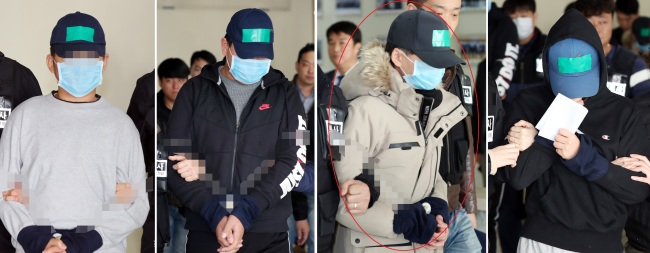 In this compilation photo, four teenagers are escorted to court on charges pertaining to the alleged bullying death of a classmate, Friday. One of the teenagers being charged (third from left) wore a jacket that had belonged to the victim. (Yonhap)