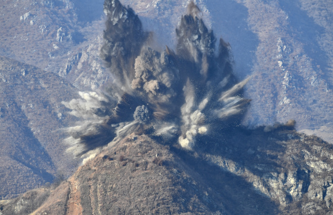 North Korea destroys its guard post inside the DMZ on Tuesday. (Yonhap)