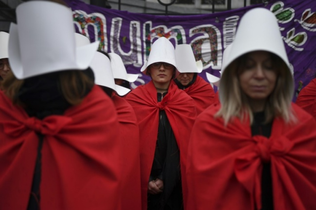 Activists in favor of the legalization of abortion don costumes inspired by Canadian author Margaret Atwood`s feminist dystopian novel