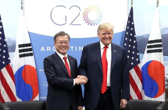 South Korean President Moon Jae-in (L) and U.S. President Donald Trump shake hands before the start of their bilateral talks held Nov. 30, 2018 on the sidelines of the Group of 20 Leaders` Summit in Buenos Aires. (Yonhap)