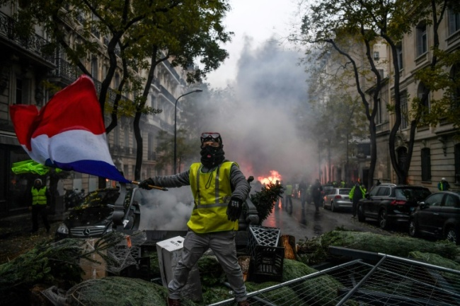 The `yellow vest` protests started over high fuel taxes (AFP)