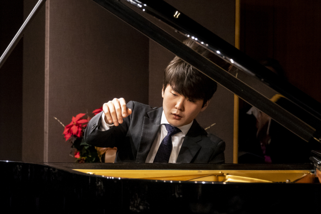 cap - Pianist Cho Seong-jin plays at the Salzburg Festival 2019 presentation held Tuesday at Oakwood Premier Coex Center in Seoul. (World Culture Networks)