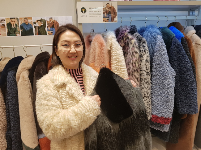 Vegan Tiger CEO Yang Yoon-a holds up a product. (Choi Ji-won/The Korea Herald)