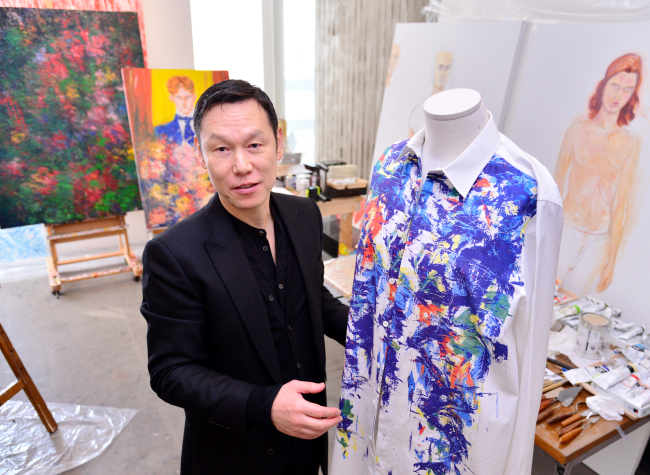 Fashion designer Song Zio speaks with The Korea Herald at his atelier-office in Seongsu-dong, eastern Seoul. (Park Hyun-koo/The Korea Herald)