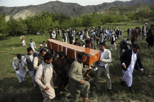 In this April 30, 2018 file photo, relatives, colleagues and friends of AFP chief photographer, Shah Marai, who was killed that day in a second suicide attack, carry his coffin in his village, Guldara, a district of Kabul province, Afghanistan. A New York-based organization dedicated to the safety of journalists says the deadliest country for journalists this year has been Afghanistan, where 13 journalists were killed. (AP)