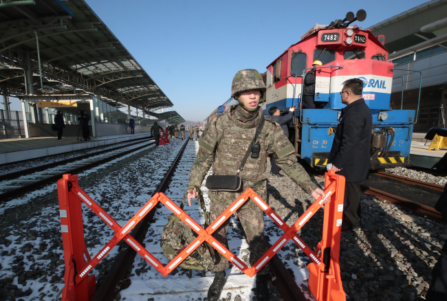 A South Korean soldier inspects the train that was used for the two Koreas` joint inspection of cross-border railways, as it enters Dorasan Station near the inter-Korean border on Dec. 18. (Yonhap)