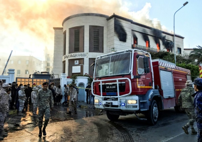 A firetruck and security officers at the scene of an attack on the Libyan foreign ministry in Tripoli on December 25, 2018. (AFP)