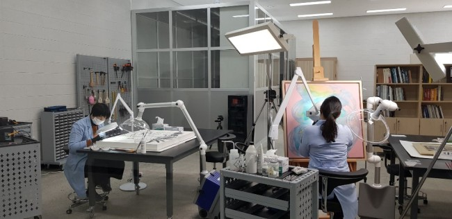 Artwork conservation and restoration specialistsare inspecting in diagnostic laboratories located on the third floorof the MMCA's Cheongju branch. (Shim Woo-hyun/The Korea Herald)