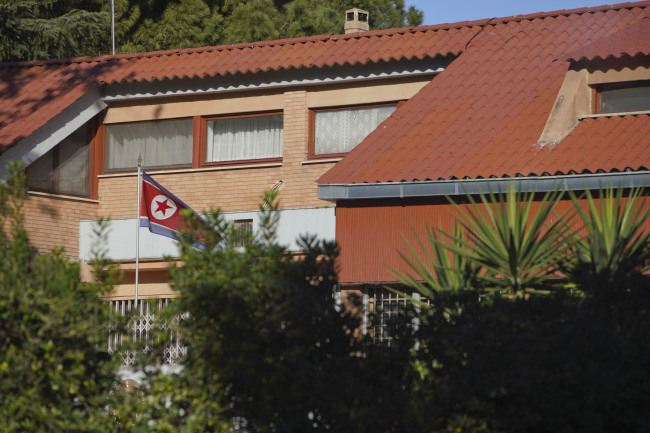 The flag of North Korea waves inside the compound of the North Korean embassy in Rome, Thursday. (AP-Yonhap)