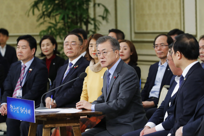 President Moon Jae-in speaks at the meeting with businesspeople running SMEs and startups at the presidential office in Seoul on Monday. Yonhap
