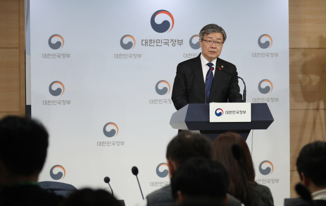 Minister of Employment and Labor Lee Jae-gap speaks at a press briefing on the revised minimum wage calculation process in northern Seoul on Monday. (Yonhap)