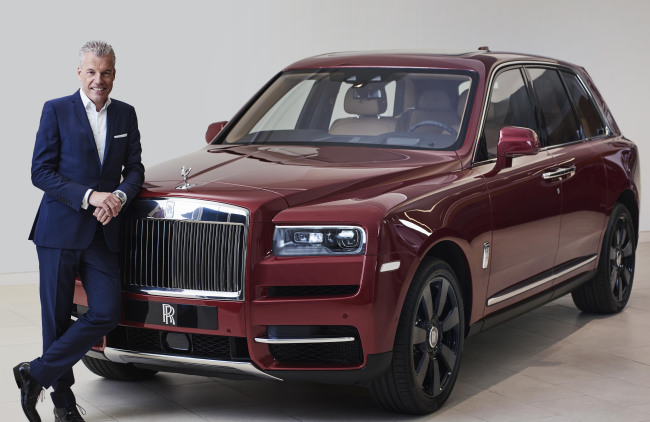 Torsten Muller-Otvos, CEO of Rolls-Royce Motor Cars, poses with Cullinan, the carmaker's first SUV. (Rolls-Royce Motor Cars)