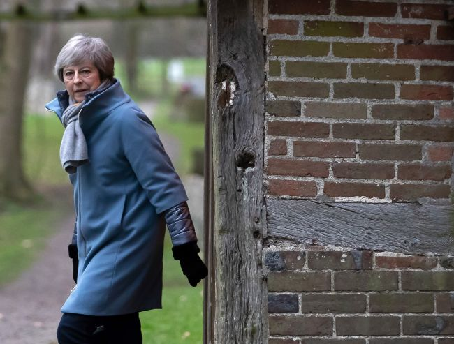 Britain's Prime Minister Theresa May leaves after attending a church service on January 13. (AFP-Yonhap)