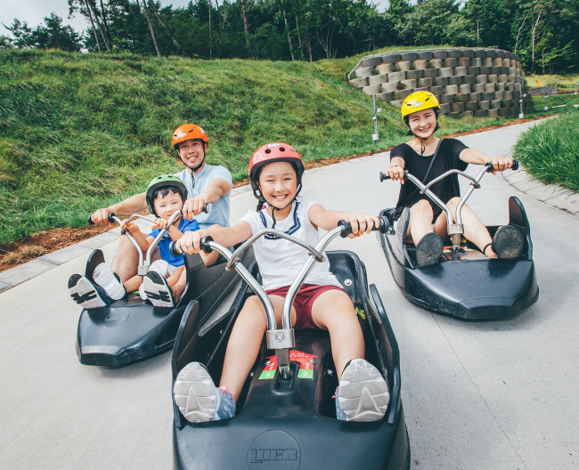 Visitors at Skyline Luge Tongyeong ride carts downhill. (Skyline Luge Tongyeong)