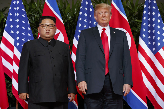 In this June. 12, 2018, file photo, US President Donald Trump (right) meets with North Korean leader Kim Jong-un on Sentosa Island, in Singapore. (AP-Yonhap)