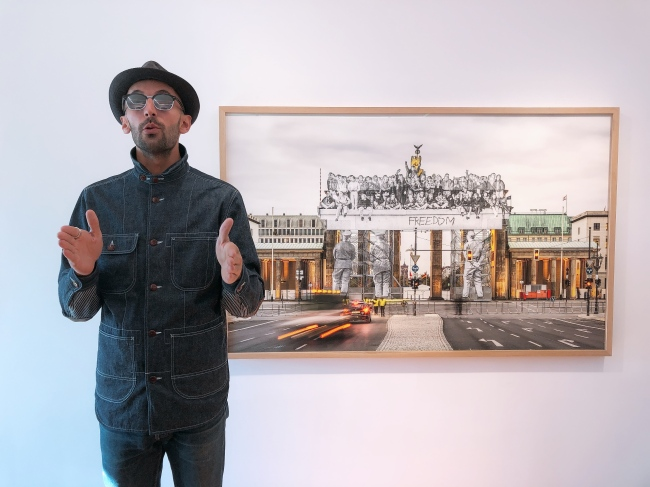 "JR= French photographer and artist JR stands next to ""Giants, Brandenburg Gate"" at Galerie Perrotin in central Seoul, Thursday. (By Kim Hye-soo/The Korea Herald)"