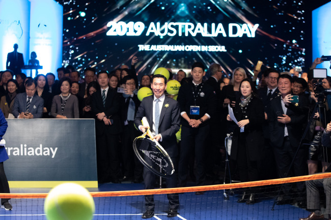 Australian Ambassador to South Korea James Choi plays an exhibition on a custom-built mini-tennis court during the 2019 Australian Day event, held at the Grand Hyatt Seoul on Jan. 25. (The Australian Embassy in South Korea)