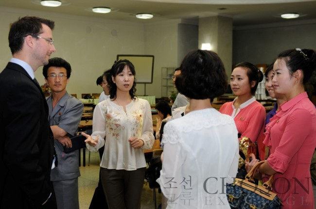 Participants to Choson Exchange's enterpreneurship workshop listen to a lecturer dispatched by the organization to North Korea in this undated photo. (Choson Exchange)