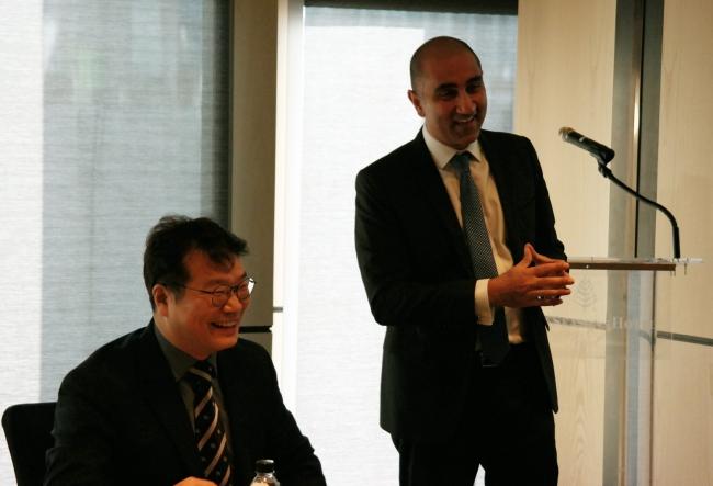 Refinitiv's Managing Director for North Asia Neil Pabari (right) and Refinitiv Korea Representative Director Kim Suk-joon speak during a media roundtable Tuesday at the Four Seasons Hotel Seoul. (Refinitiv)