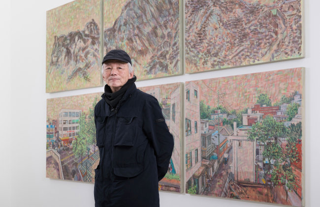 """Painter Min Joung-ki poses for pictures in front of his 2019 work """"Mt. Inwang"""" (Kukje Gallery)"""