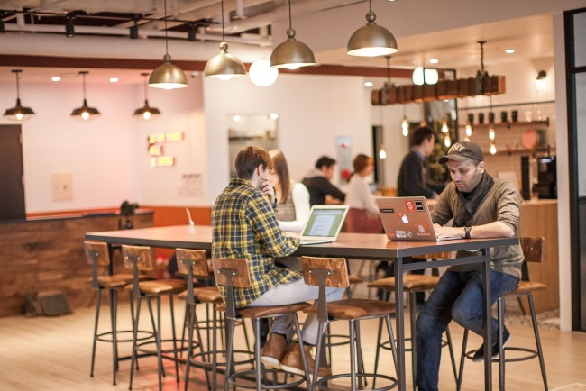 Startup employees work at one of coworking spaces run by office-sharing firm Fast Five in Seoul. (Fast Five)