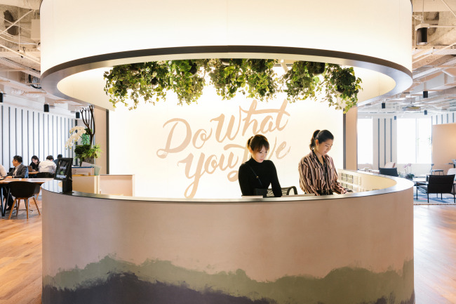 Employees of coworking space firm WeWork handle front desk duties at the firm's Ark Hills South location in Tokyo. (WeWork)
