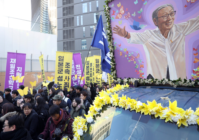 Funeral procession of Kim Bok-dong passes the site of the old Japanese embassy in Seoul on Friday. Yonhap
