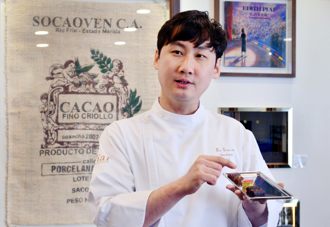 Piaf Artisan Chocolatier's owner-chocolatier Ko Eun-su speaks during an interview with The Korea Herald at the shop. (Park Hyun-koo /The Korea Herald)