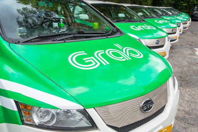 Grab vehicles are parked in Singapore. (Grab)