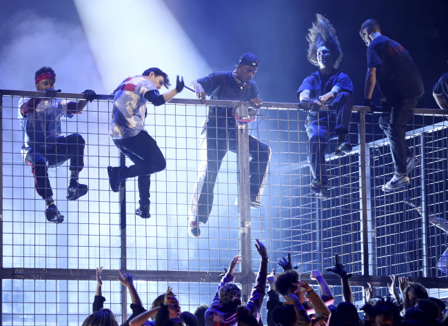 Travis Scott, center, climbs a cage during a performance at the 61st annual Grammy Awards on Sunday, Feb. 10, 2019, in Los Angeles. (AP)