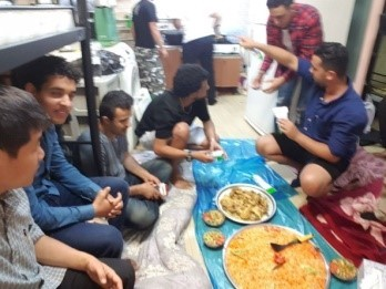 Yemeni asylum seekers prepare and share food in Itaewon, central Seoul, at the Union of Yemen Community in Korea. (Union of Yemen Community in Korea)