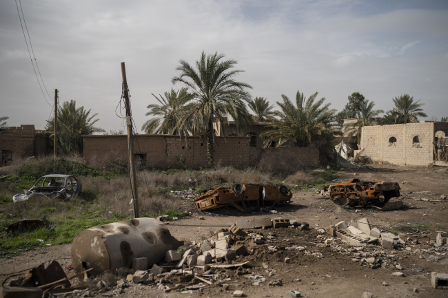 Damaged cars sit in an area recently retaken by U.S.-backed Syrian Democratic Forces (SDF) from Islamic State militants in Susah, Syria, Saturday, Feb. 16, 2019. (AP)