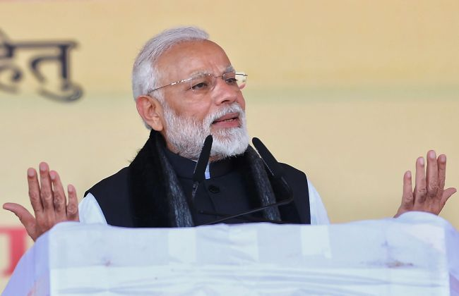 Indian Prime Minister Narendra Modi speaking during the inauguration and foundation stone laying ceremony of various development projects in Jhansi, in the Indian state of Uttar Pradesh, Feb. 15.