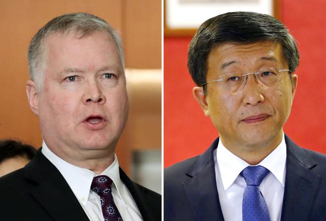 Stephen Biegun (left) and Kim Hyok-chol (Yonhap)