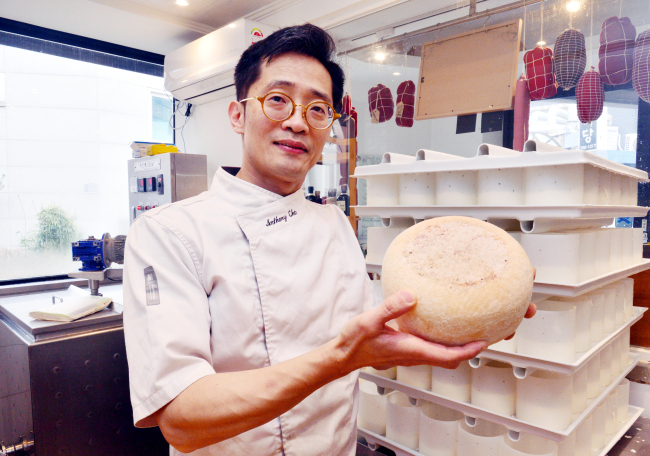 Chef-cheesemaker Cho Jang-hyun poses for photos at his restaurant Cheeseflo's cheese-making studio in Hannam-dong, central Seoul.