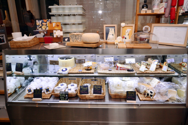Various types of house-made cheese are displayed for sale at Cheeseflo. (Park Hyun-koo / The Korea Herald)