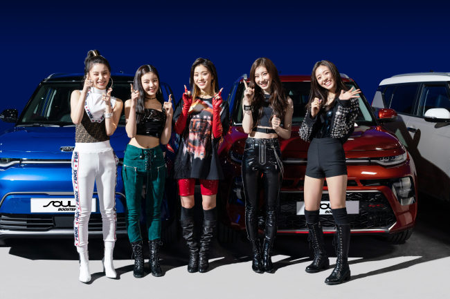 "Members of ITZY stand in front of Kia Motors' Soul Booster, featured in their debut music video, ""Dalla Dalla."
