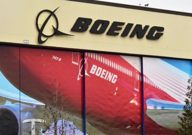 Boeing Co`s logo is seen above the front doors of its largest jetliner factory in Everett, Washington, US January 13, 2017. (Reuters)