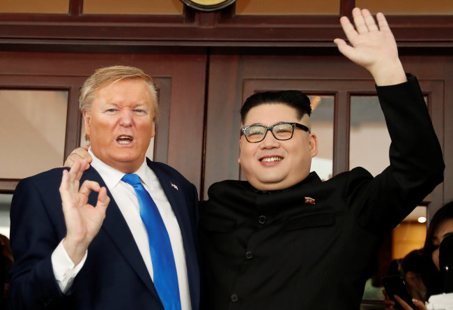 US President Donald Trump impersonator Russell White, left, and Kim Jong-un impersonator Howard X pose for photos outside the Opera House in Hanoi, Vietnam, Friday, Feb. 22, 2019. (Reuters)