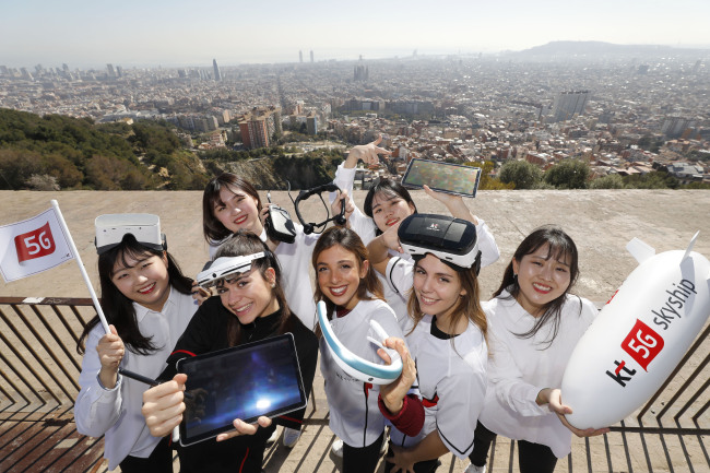 KT employees show various products featuring KT`s 5G services in time for the MWC 2019 being held in Barcelona, Spain, this week. (Yonhap)