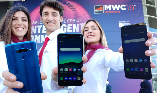 LG Electronics` employees present new LG Q60 (from left), LG K50, and LG K40, which will be showcased at the MWC 2019 being held in Barcelona, Spain, this week, along with its new 5G smartphone. (Yonhap)