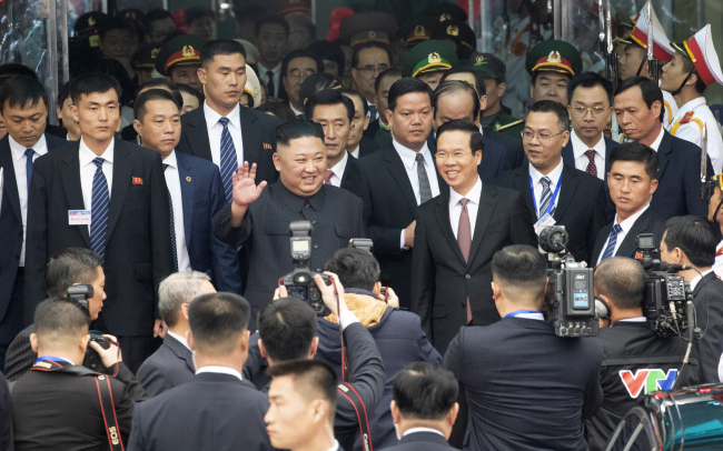 North Korean leader Kim Jong-un waves at Dong Dang Railway Station in Vietnam on Tuesday. Yonhap