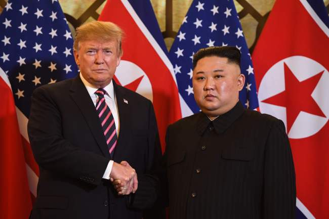 US President Donald Trump (Left) shakes hands with North Korea's leader Kim Jong Un before a meeting at the Sofitel Legend Metropole hotel in Hanoi on Wednesday. (AFP-Yonhap)