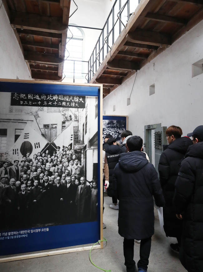 "Visitors take a look around the exhibition ""100 Years of History Preserved in Cultural Heritage"" at the Seodaemun Prison History Museum in Seoul in this Feb. 18 file photo. / Yonhap"